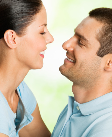 Portrait of beautiful young happy smiling carefree couple, outdoor photo