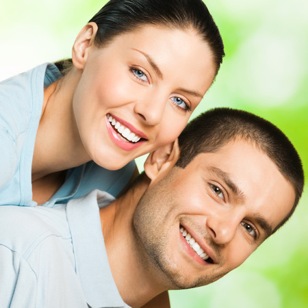 carefree: Portrait of beautiful young happy smiling carefree couple, outdoor