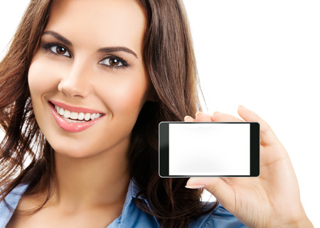 Portrait of smiling young businesswoman showing no-name blank cellphone with copyspace, isolated against white background photo