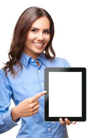 Happy smiling beautiful young businesswoman showing blank no-name tablet pc monitor, isolated against white background, with copyspace area Stock Photo