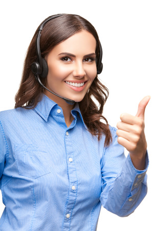Portrait of smiling cheerful customer support phone operator in headset showing thumb up gesture, isolated against white background photo