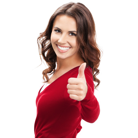 Portrait of cheerful young woman showing thumbs up gesture, isolated over white background
