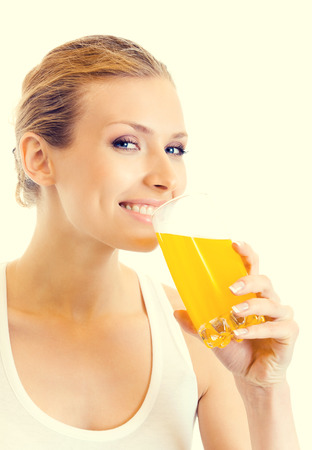 blondy: Portrait of young woman in fitness wear drinking orange juice