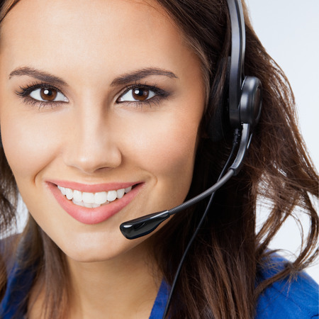 phone operator: Portrait of cheerful beautiful young support phone operator in headset Stock Photo