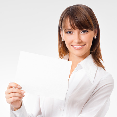advertising space: Happy smiling young businesswoman showing blank signboard Stock Photo