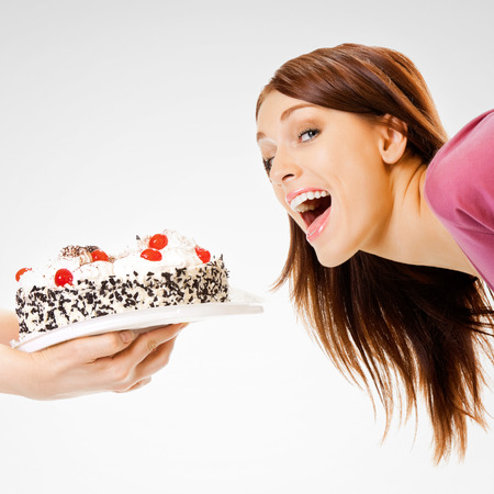 glutton: Young woman eating pie Stock Photo