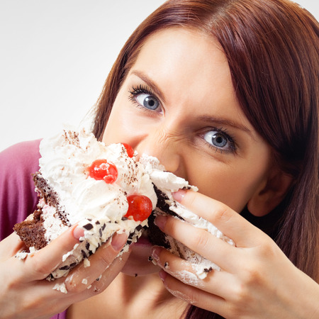 gluttonous: Woman eating pie
