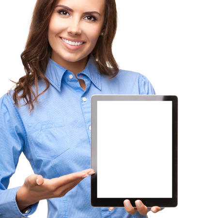 pocket pc: Cheerful beautiful young businesswoman showing no-name blank tablet pc for copyspace, isolated against white background