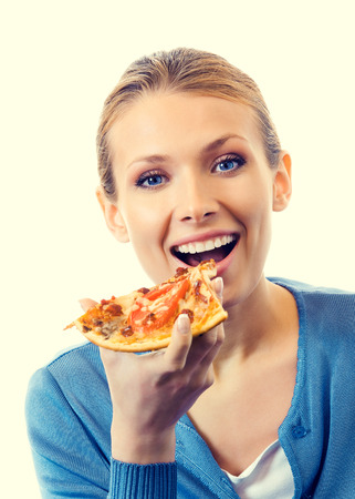 Beautiful young woman eating pizza 스톡 콘텐츠