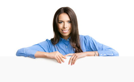 Portrait of cheerful smiling young businesswoman showing blank signboard with copyspace for text, isolated over white background photo