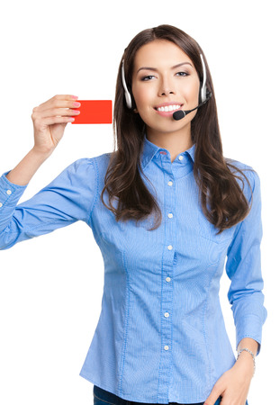 debet: Happy smiling beautiful young customer support phone operator in headset, showing red blank business or plastic credit card, isolated over white background