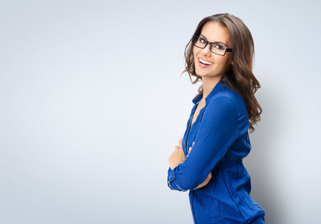 Portrait of happy smiling young beautiful businesswoman in glasses, with copyspace area Archivio Fotografico