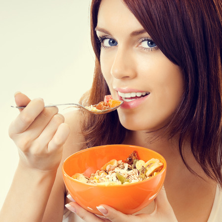muslin: Portrait of young attractive woman eating muslin Stock Photo