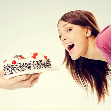 woman eating cake: Portrait of young beautiful woman eating pie