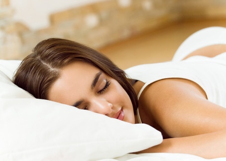 lazyness: Young woman sleeping on bed