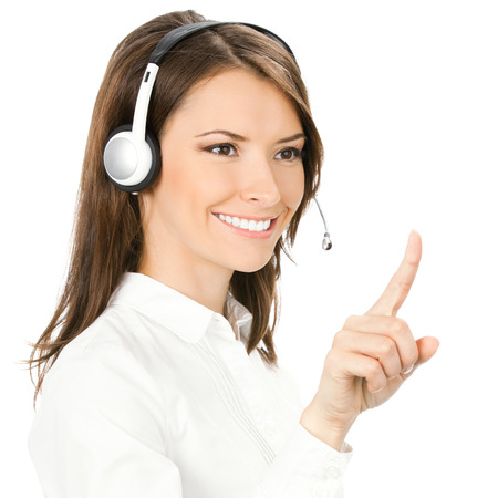 Portrait of happy customer support phone operator in headset pointing at something, isolated against white background photo