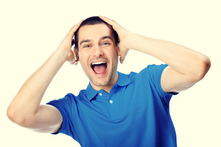 amazed: Portrait of expressive surprised or shocked happy young handsome man in blue casual t-shirt clothing