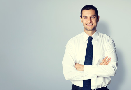 Portrait of young businessman with crossed arms pose, with blank copyspace area for text or slogan photo
