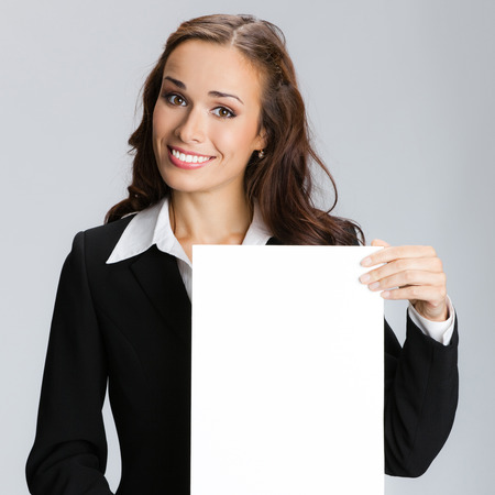 blank area: Businesswoman showing signboard with blank copyspace area for text or slogan