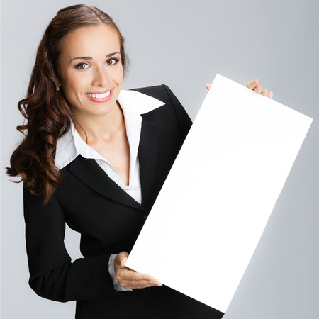 signboard: Happy young attractive businesswoman showing signboard with blank copyspace area for text or slogan