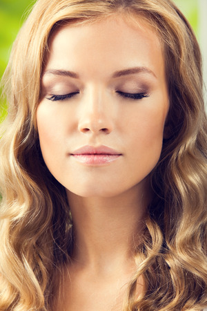 closed up: Portrait of young beautiful woman with closed eyes, closeup