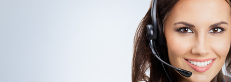 customer support: Portrait of happy smiling support phone operator or businesswomen in headset, with blank copyspace area for slogan or text