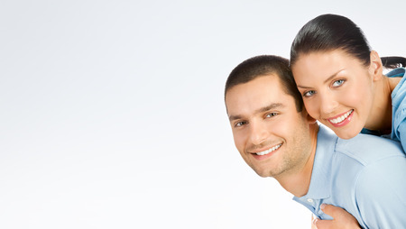 for text: Portrait of amorous young couple, with copyspace blank area for text or slogan, against grey background