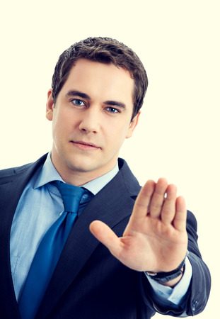 interdiction: Serious senior businessman showing stop gesture Stock Photo