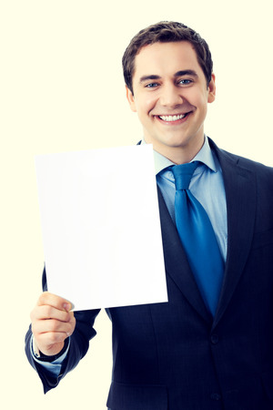 Happy smiling businessman showing blank signboard with blank empty copyspace area for sign or slogan text. Marketing and advertising concept. photo