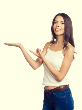 empty tank: Young woman in tank top casual smart clothing, showing something or blank empty copyspace area for text or slogan Stock Photo