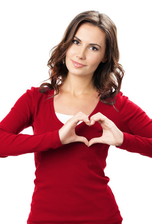 hand over: Happy smiling beautiful young brunette woman showing heart symbol hand sign gesture, isolated over white background