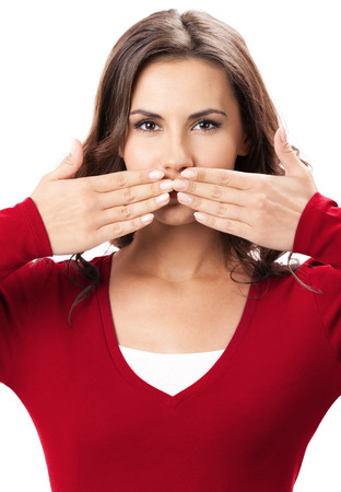 hearsay: Young brunette woman covering with hands her mouth, isolated on white background Stock Photo