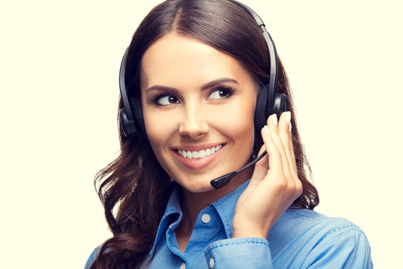 handsfree phones: Portrait of happy smiling cheerful customer support phone operator. Customer assistance service concept. Stock Photo