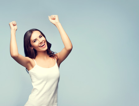 Portrait of cheerful gesturing smiling young brunette woman, with blank copyspace area for text or slogan Stock Photo