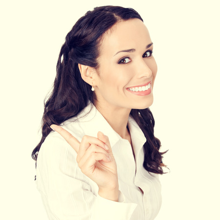 copyspase: smiling young businesswoman showing blank area for sign or copyspase