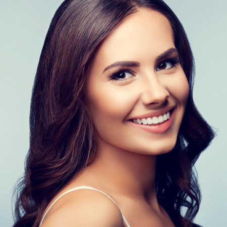 brunette woman: Portrait of cheerful smiling young lovely brunette woman Stock Photo