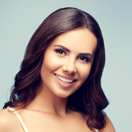 brunette woman: Portrait of happy smiling young lovely brunette woman