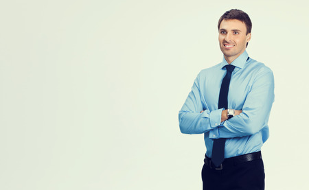 business attire teacher: Portrait of young happy smiling businessman, in blue confident business wear, with blank copyspace area for slogan or text message Stock Photo