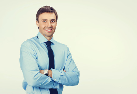 business attire teacher: Portrait of young happy smiling businessman in blue confident business wear, with blank copyspace area for slogan or text message