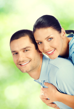embracing couple: Portrait of happy smiling amorous embracing lovely couple, outdoors Stock Photo