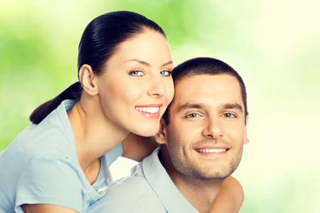 embracing couple: Portrait of young happy amorous embracing lovely couple, outdoors Stock Photo