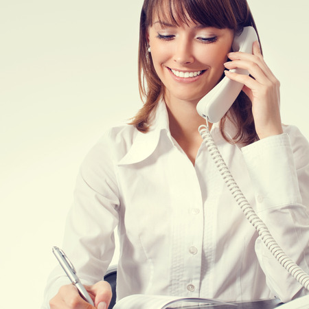 sales agent: happy businesswoman in white business style clothing or support phone worker