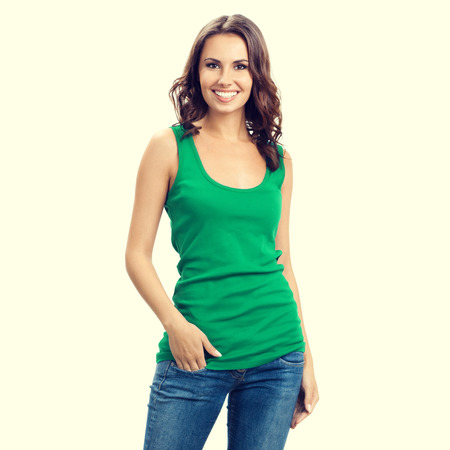green clothes: happy smiling young brunette woman in smart green casual clothing