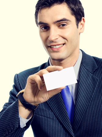 debet: Portrait of happy smiling businessman in blue tie, giving businesscard or bank credit card with blank copyspace area for slogan or text message