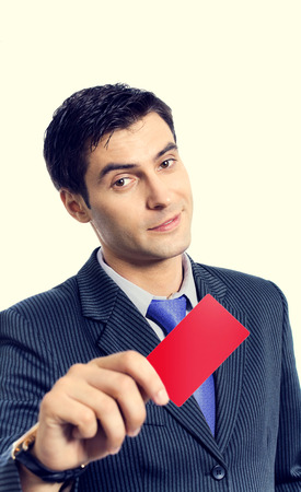 businesscard: Businessman in blue tie, giving blank red card or businesscard with blank copyspace area for slogan or text message Stock Photo