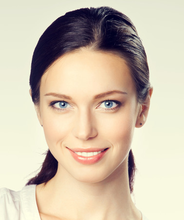 Portrait of smiling young attractive businesswoman