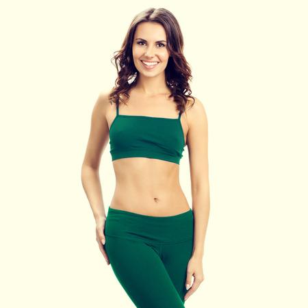 sports wear: portrait of smiling woman in green sports wear