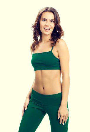 sports wear: portrait of smiling lovely woman in green sports wear