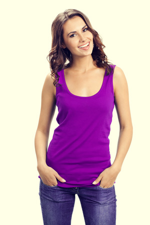 one person only: Portrait of young smiling woman in casual smart lilac clothing