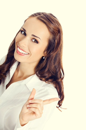 copyspase: Happy smiling young business woman showing blank area for sign or copyspase